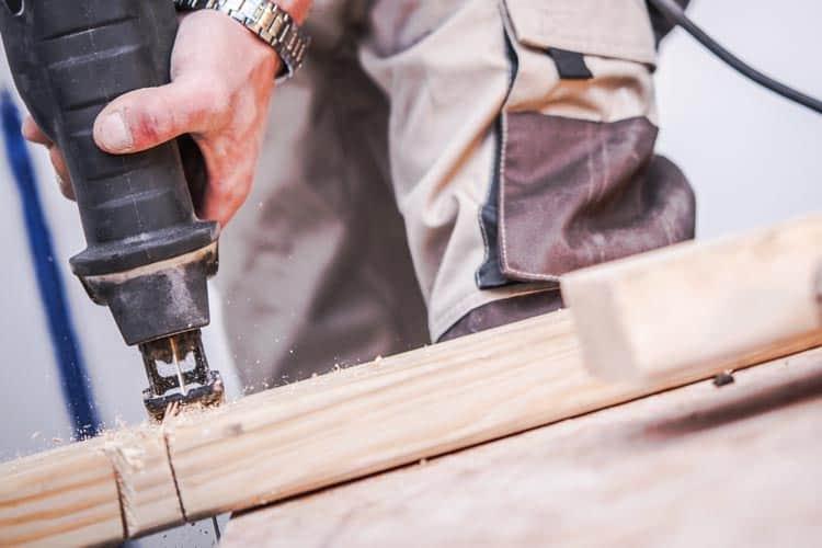 Reciprocating saw cutting through wood