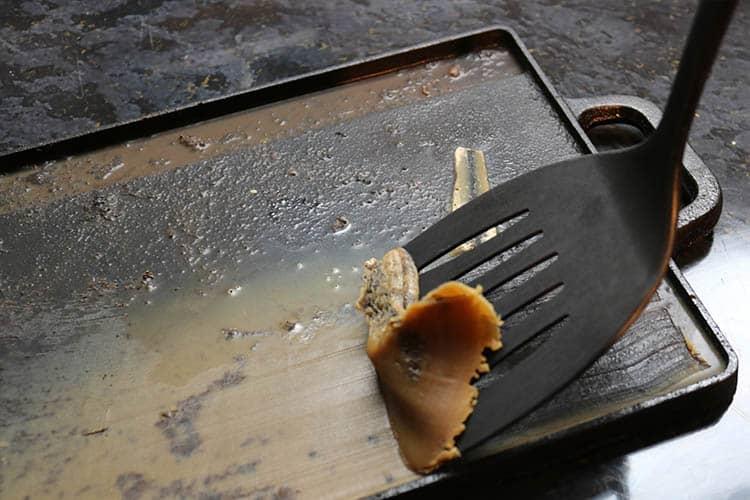 Scrape the fat off with a plastic spatula