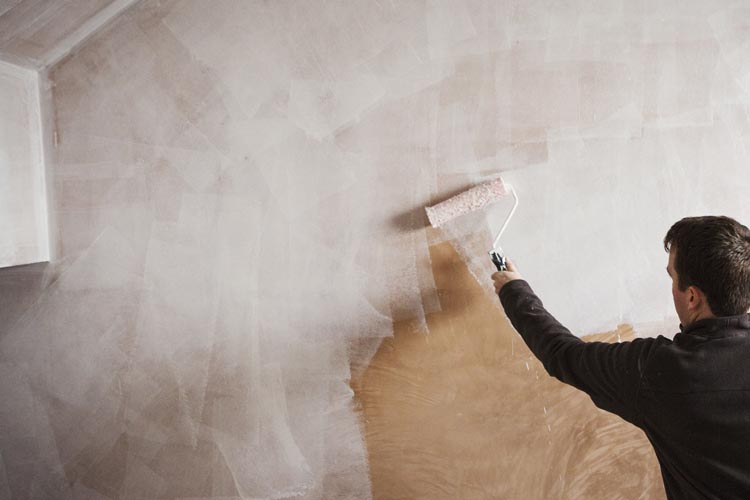 Can you paint over dark wallpaper?