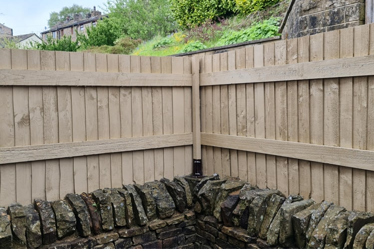 Fence painted with masonry paint