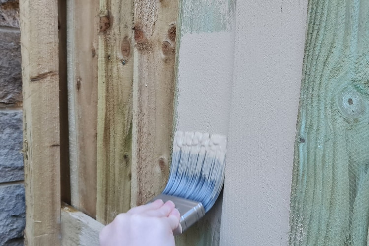 Painting a fence with masonry paint