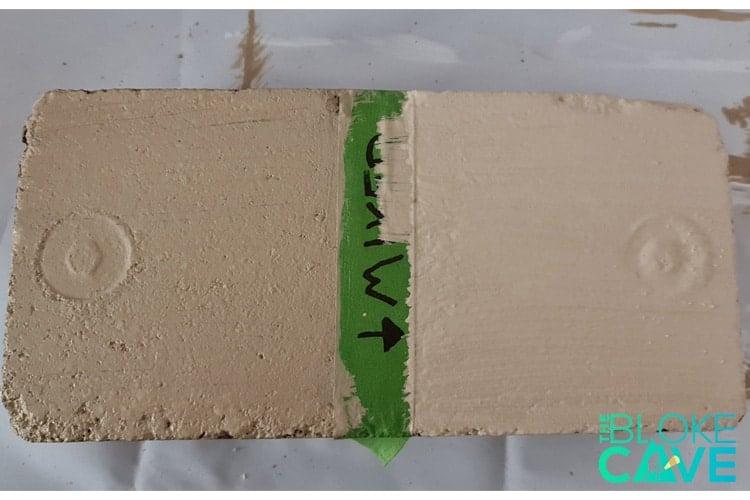 colour mixed masonry paint on a brick