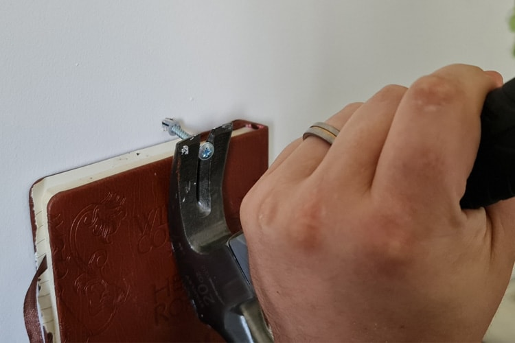 Lever out using a claw hammer