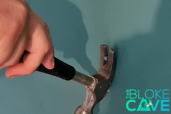 Using a claw hammer works well